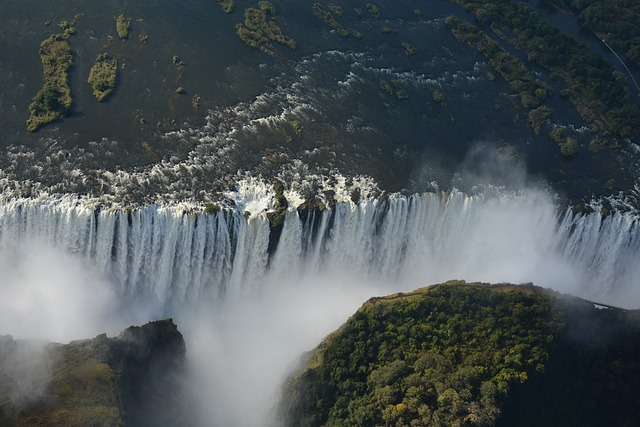 Water-spraying happiness at Victoria Falls Africa