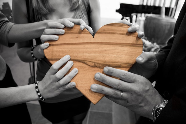 people holding heart together